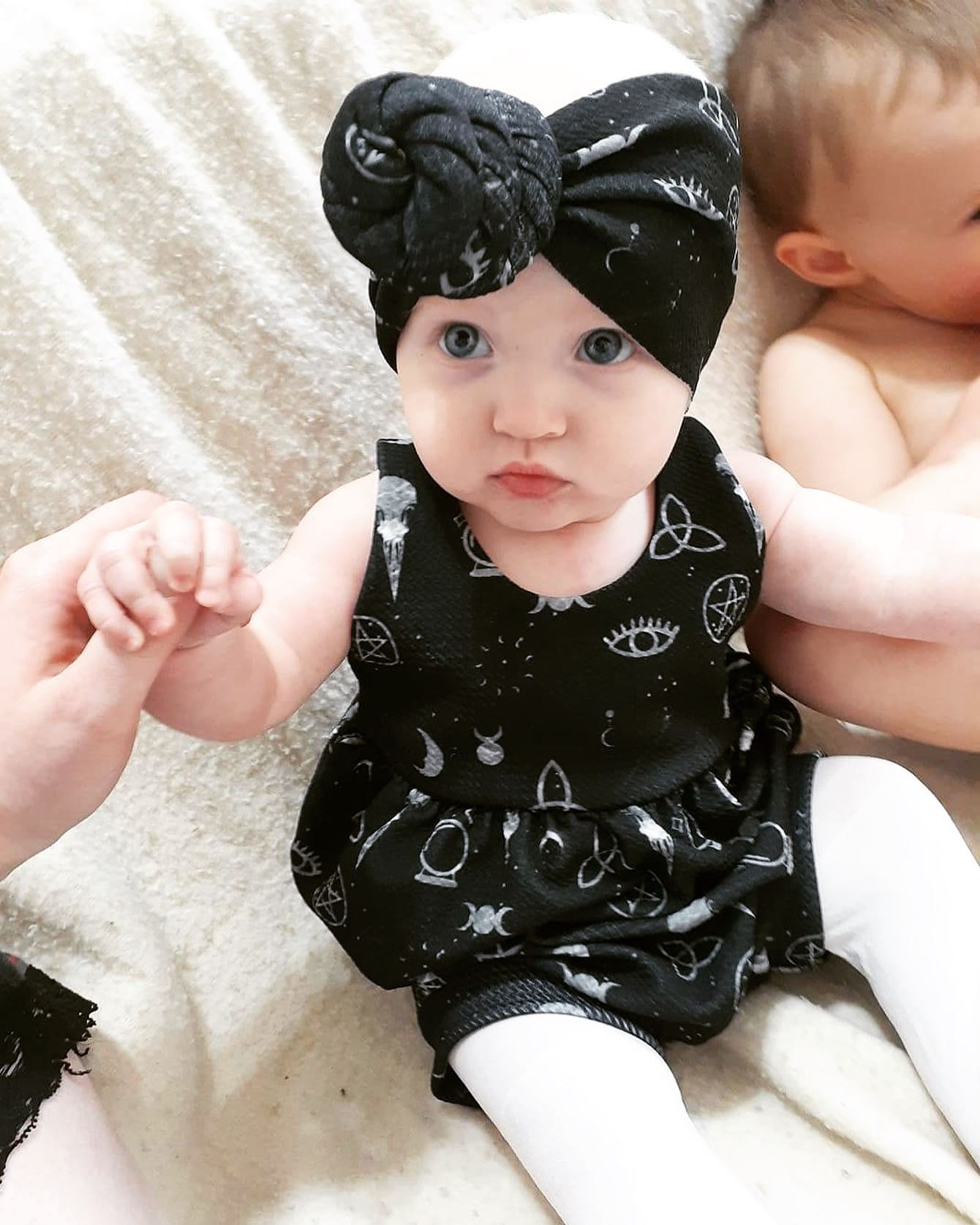 There's miss Kennedy in her 𝓢𝓹𝓮𝓵𝓵𝓫𝓸𝓾𝓷𝓭 romper and top knot #witchyvibes #babiesofinstagram #topknot #babyrompers…