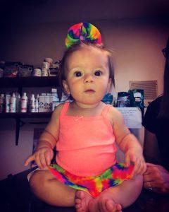 Emmersyn wearing her rainbow skirted bummies for her 1/2 birthday #babiesofinstagram #handmadewithlove #rainbows #smallshoplove